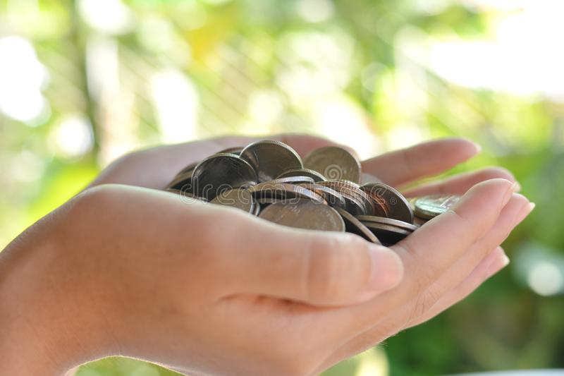 Money in the hands of the girl stock image