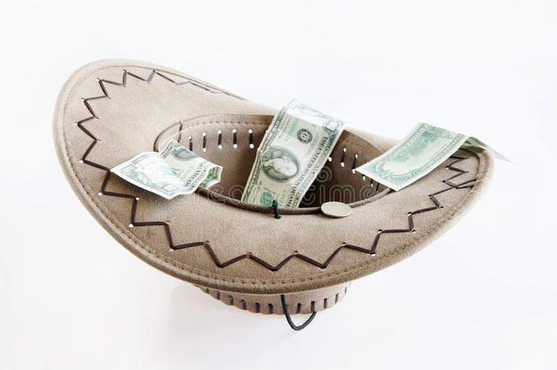 Money in a hat. Financial crisis stock photography