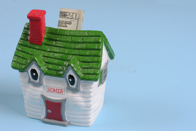 Money into the house. Money being put into a home royalty free stock image