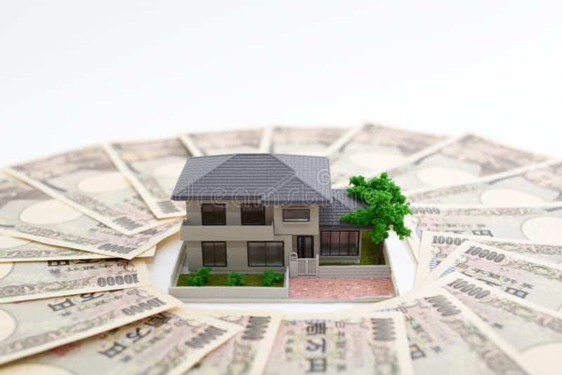 Money and house model. Isolated on white background stock image