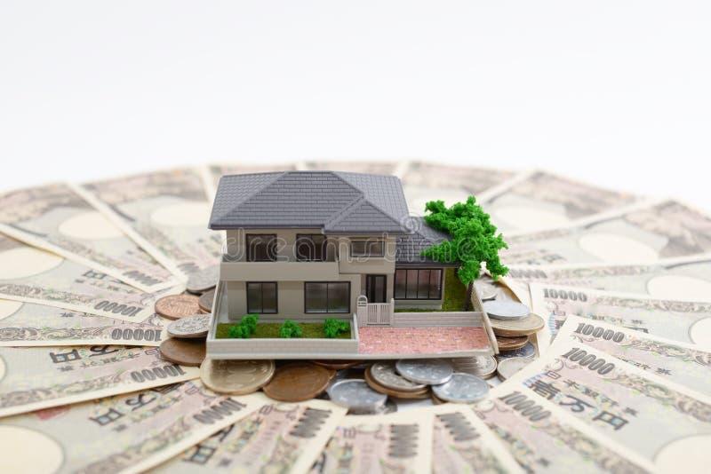 Money and house model. Isolated on white background stock photo
