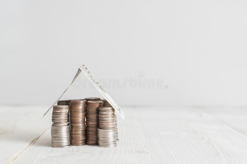 Money house of us cents coins. And 5 dollars banknote royalty free stock images
