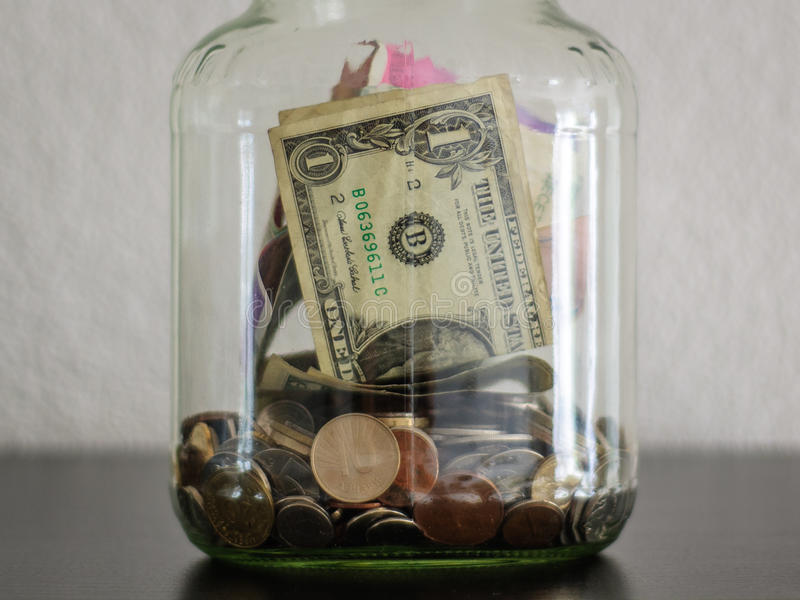 Money in a jar stock photography