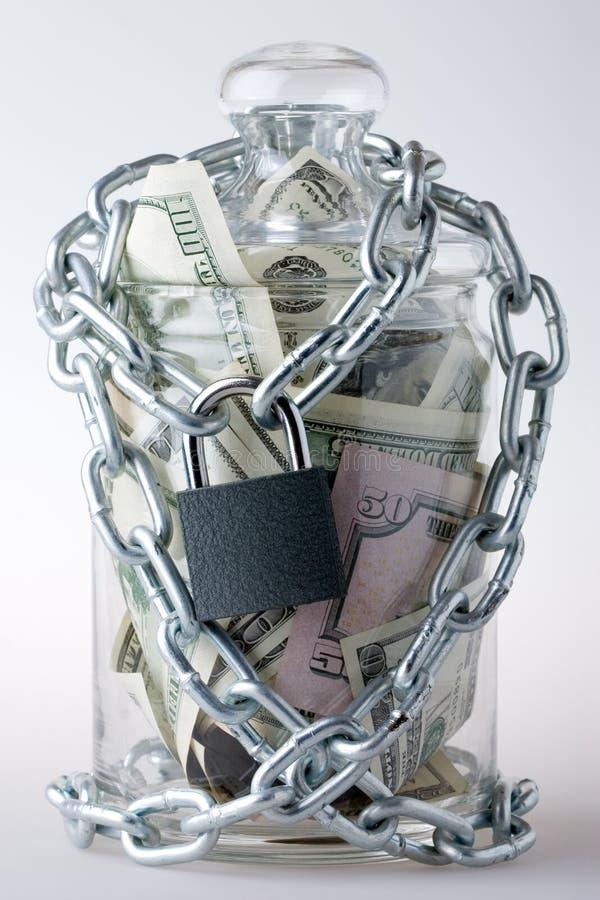 Money jar and padlock stock image