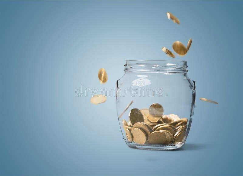 Money jar. Save savings pension growth falling cash royalty free stock photo