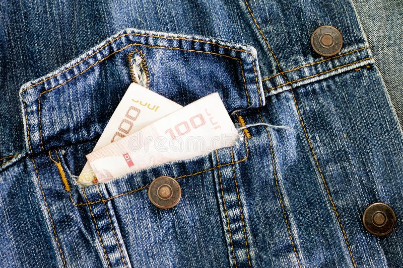Money in Jean Pocket for business shopping and other. stock photo