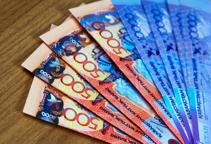 Money of Kazakhstan, banknotes tenge. Large denominations for a wooden table stock photo