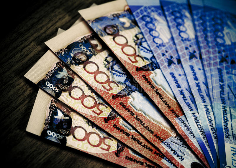 Money of Kazakhstan. Large denominations for a wooden table royalty free stock photos