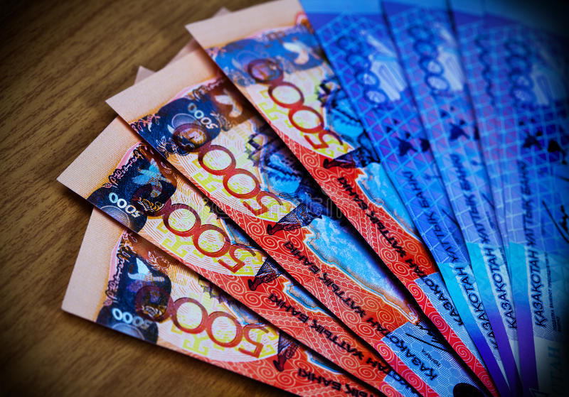 Money of Kazakhstan. Large denominations for a wooden table royalty free stock image