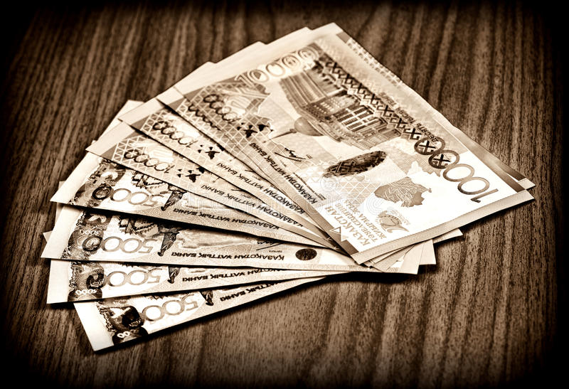 Money of Kazakhstan. Large denominations for a wooden table in vintage style royalty free stock photography