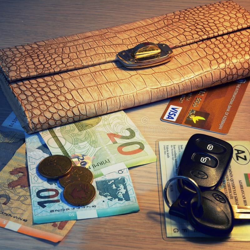 Money, visa card, banknotes, wallet. Key, money, coins in purse stock image