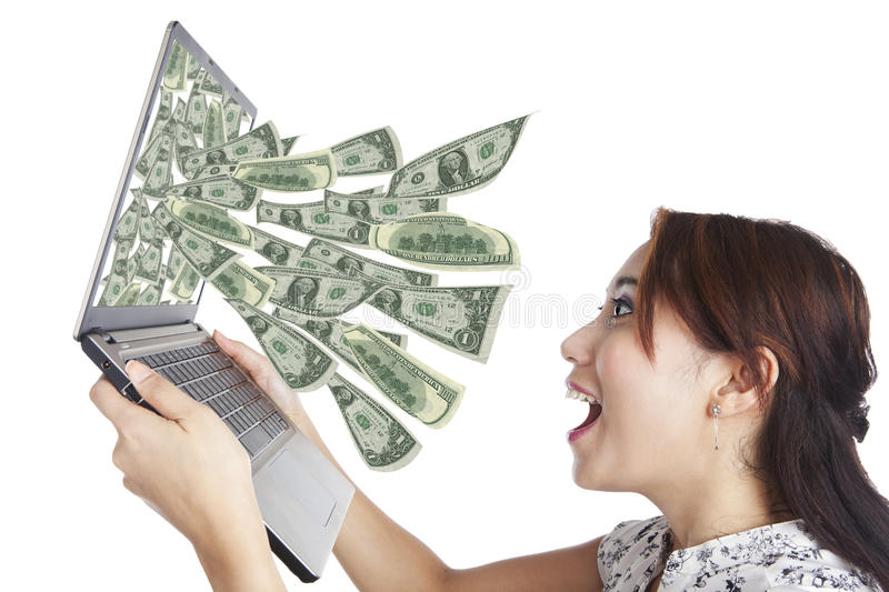 Money from laptop royalty free stock photo