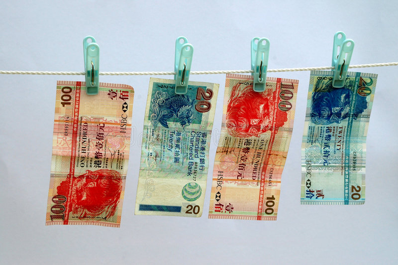 Money laundering Hong Kong Dolllars. Hong Kong dollars or currency on a laundry (wash) line with blue background stock photos