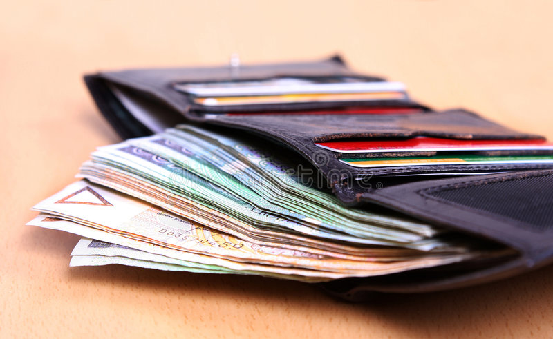 Money in leather wallet royalty free stock photos