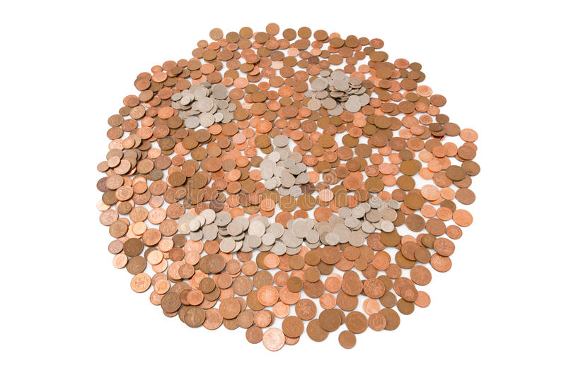 Money Makes Me Laugh. Description: A smiley face made from bronzer and silver coins. My little way of putting a smile on the current economic crisis Location stock photo