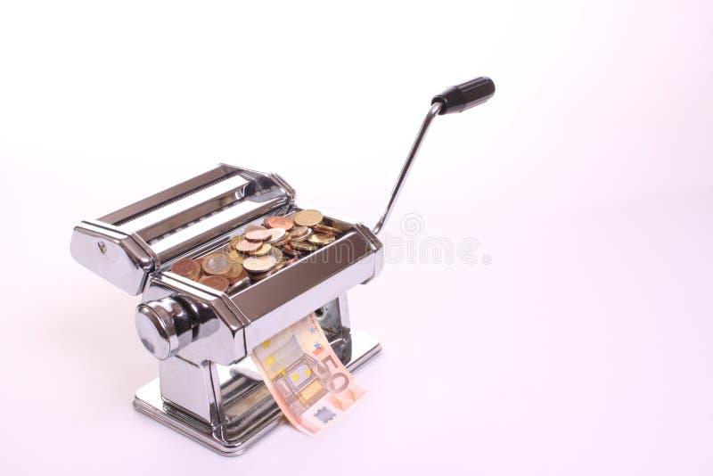 Money-making pasta machine stock image