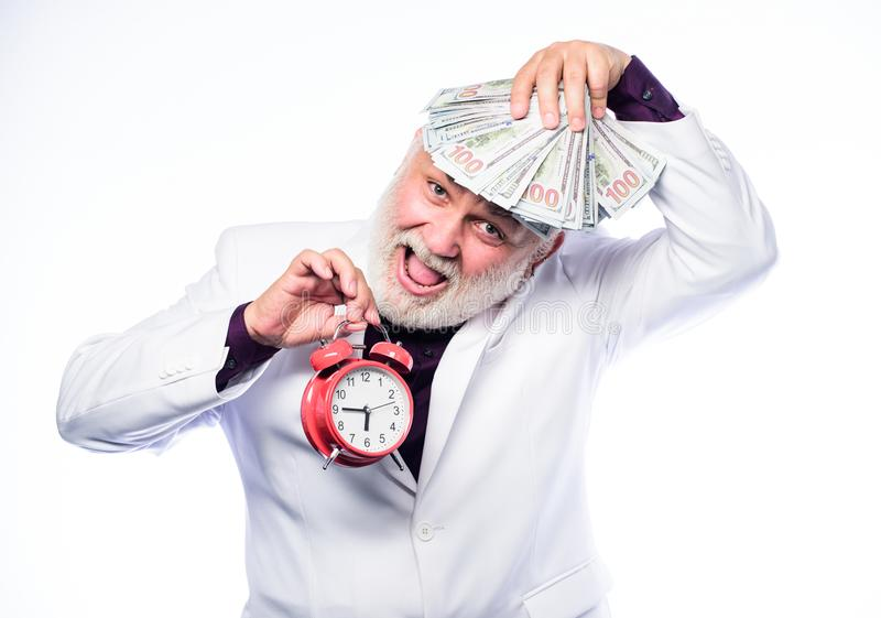 Money. mature man with beard hold money. clock show time. time is money. time management. business success. retirement royalty free stock images