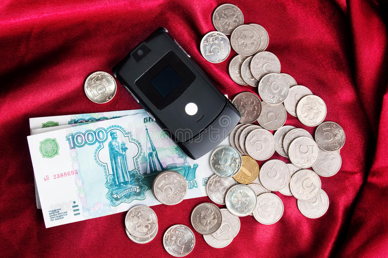 Money with mobile stock photography