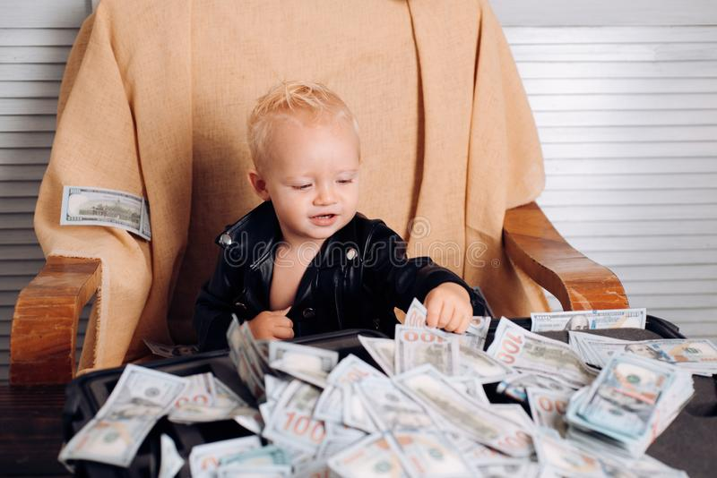 Money is no problem. Small child do business accounting in startup company. Startup business costs. Little entrepreneur. Work in office. Boy child with money stock photography