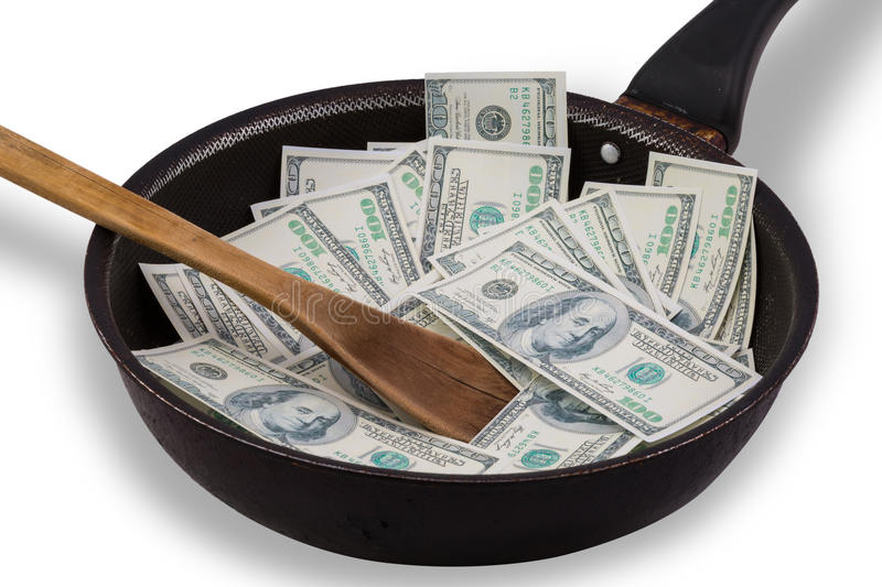 Money in Non stick frying pan. Money in used Non stick frying pan isolated on white stock image