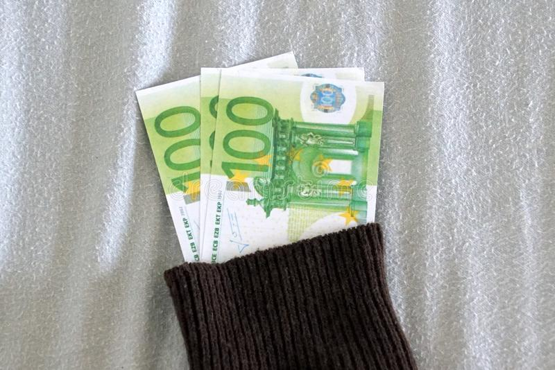 Money in a old sock. Hiding money in a old sock stock photos