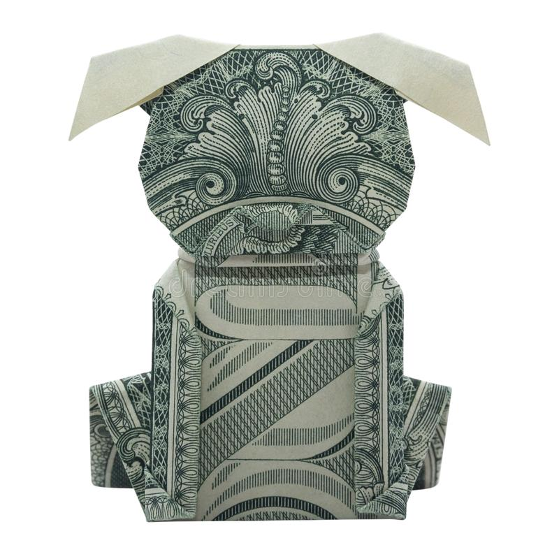 Money Origami Puppy Dog Folded with Real One Dollar Bill Isolated royalty free stock image