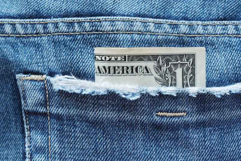 Money out of pocket. One us dollar banknote out of pocket royalty free stock photo