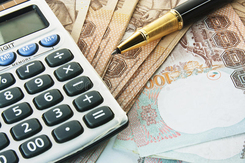 Money, pen and calculator. Coins,bank notes,classic pen and calculator royalty free stock photography