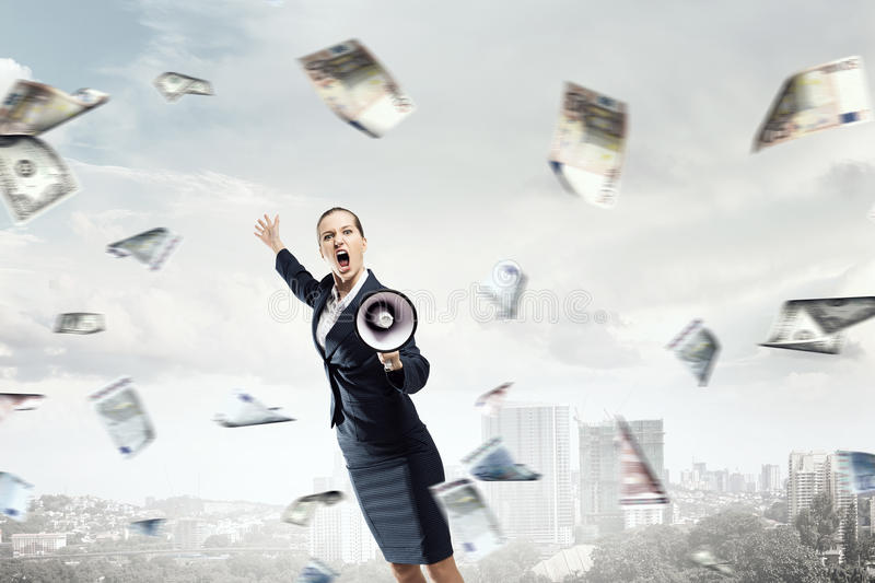 Money people and financial news concept . Mixed media. Young emotional businesswoman screaming in megaphone and money falling from above. Mixed media stock photos