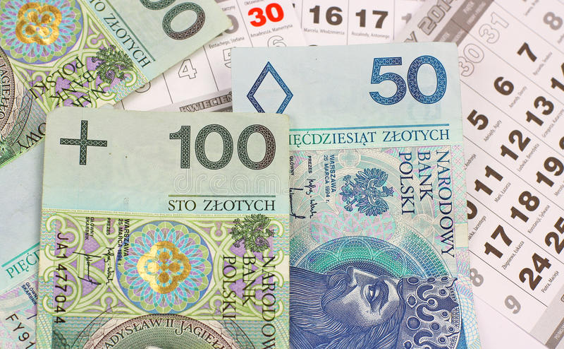 Money PLN on a calendar. Banknotes of polish pln on calendar sheets close-up stock images