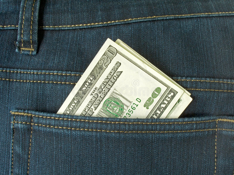 Money in pocket. Blue jeans royalty free stock photos