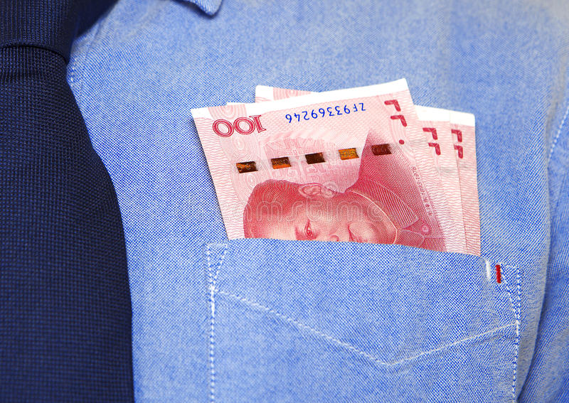 Money in the pocket. Chinese money in the front pocket of shirt,three hundred yuan stock photography