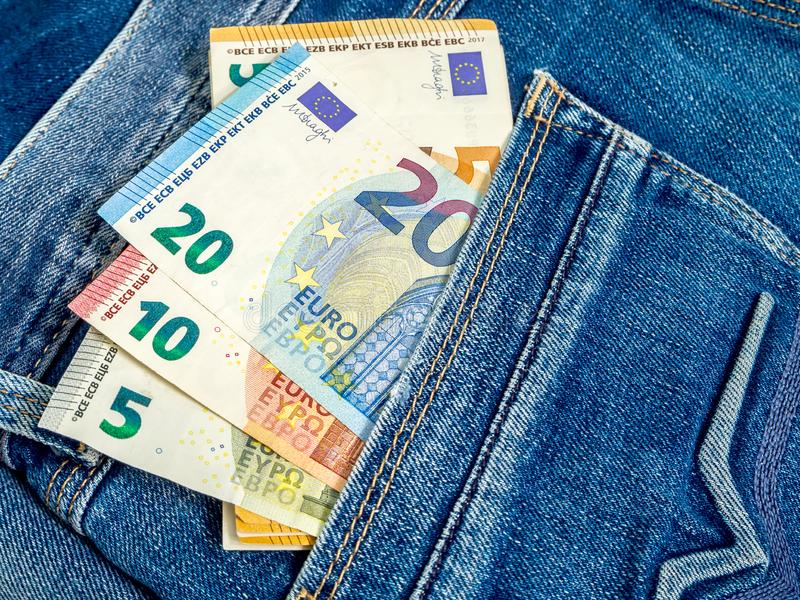 Money in the pocket stock images