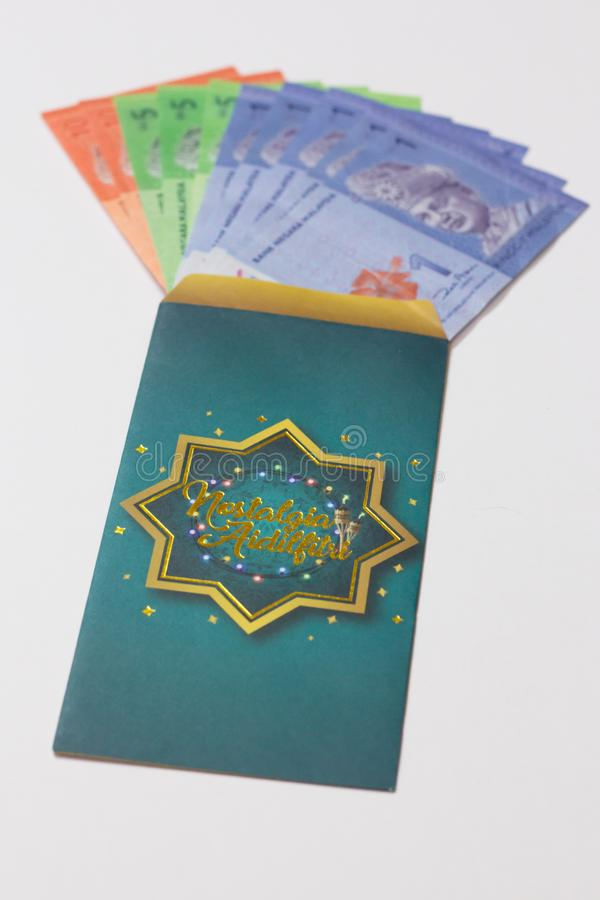 Money pocket is given from adult to children during Eid Mubarak celebration in Malaysia. `Duit Raya` is money given from adult to children during Eid Mubarak stock images