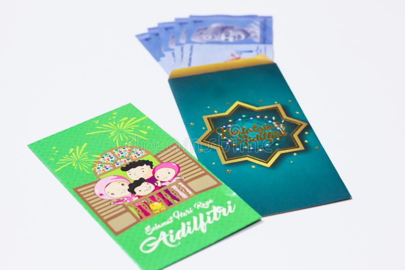 Money pocket is given from adult to children during Eid Mubarak celebration in Malaysia. `Duit Raya` is money given from adult to children during Eid Mubarak stock photos