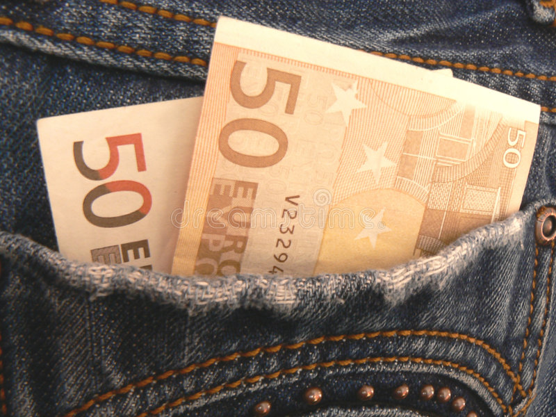 Money in pocket jeans royalty free stock photography