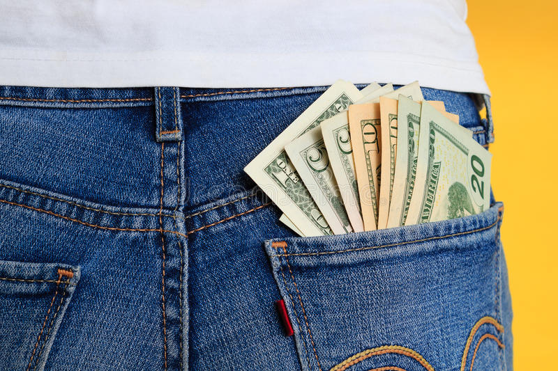 Money in pocket, rear view stock photo