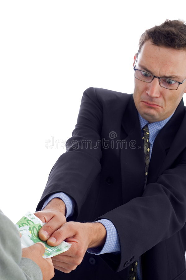 Money pulling. Angry businessman struggling to take the money stock photos