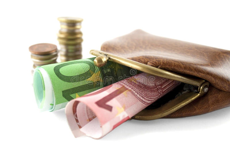 Money and purse. Purse with euro banknotes and coins isolated over white royalty free stock image