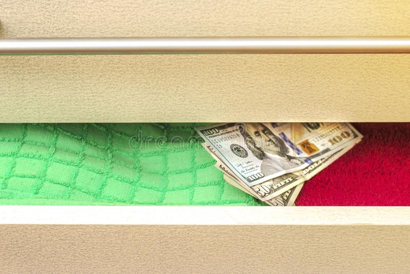 Money put on to keep a stash in the chest of drawers stock photography