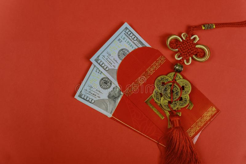 Money in red envelopes Chinese new year greeting gift, closed up of US dollar banknotes in red traditional envelopes stock photo