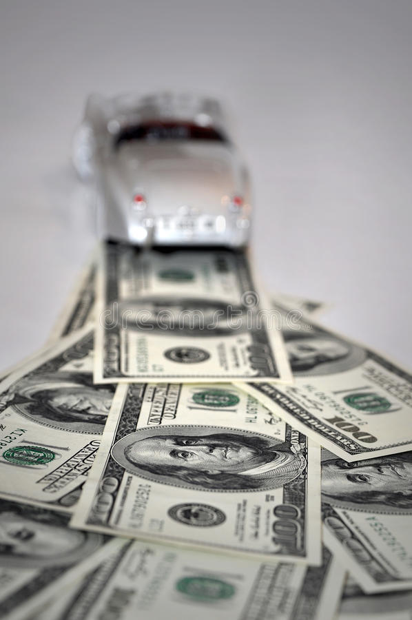 Money road concept with toy car. Money dollars road concept with toy car stock images