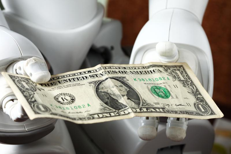 Money and robot. royalty free stock photography