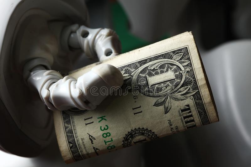 Money and robot. stock photo