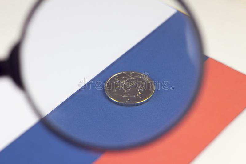 The money of russia against the background of the flag increased through a magnifying glass politics royalty free stock photography