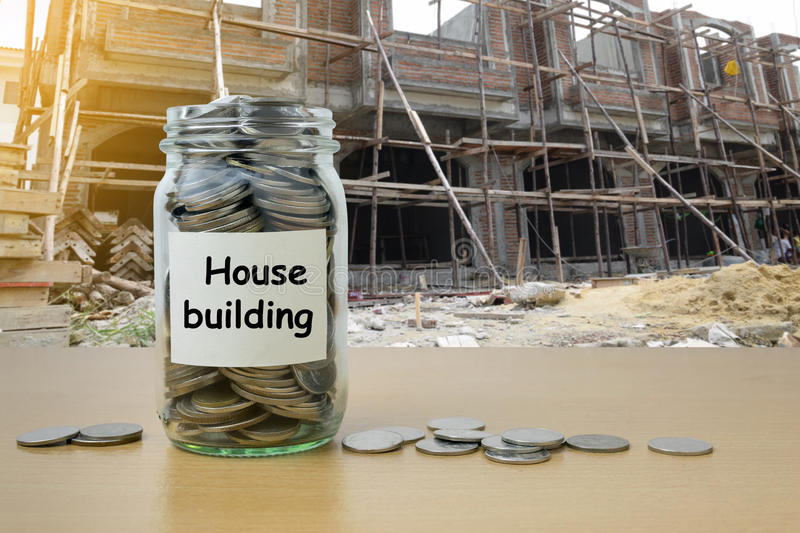 Money saving for House building. In the glass bottle royalty free stock photos