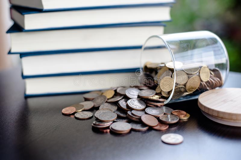 Money Saving Money Saving Ideas Save money, preset ideas by hand. Put money in the money stack business stock images