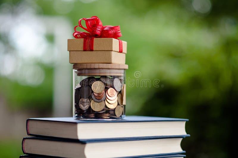 Money Saving Money Saving Ideas Save money, preset ideas by hand. Put money in the money stack business stock image