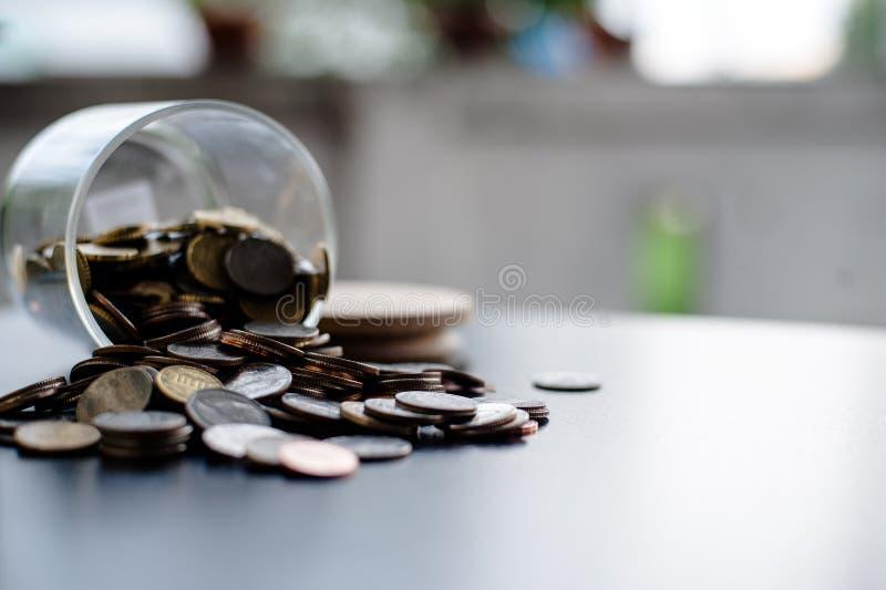 Money Saving Money Saving Ideas Save money, preset ideas by hand. Put money in the money stack business stock photos