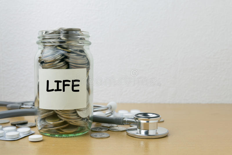 Money saving for life in the glass bottle royalty free stock photos
